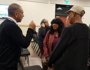 "City of Lynwood Director of Parks and Community Services Mark Flores, Barbara Battle and Saundra Johnson chat after the ""On the Move"" Lynwood City Council meeting."